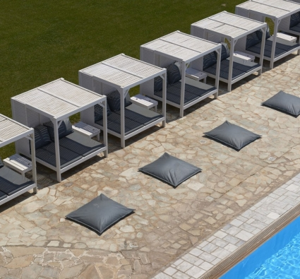 Tinos Beach Hotel day beds by the pool